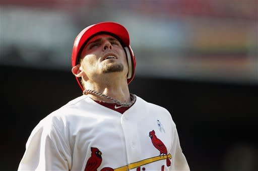 St. Louis Cardinals' Tyler Greene reacts after flying out during the 14th inning of a baseball game against the Kansas City Royals, Sunday, June 17, 2012, in St. Louis. The Royals won 5-3. (AP Photo/Jeff Roberson)