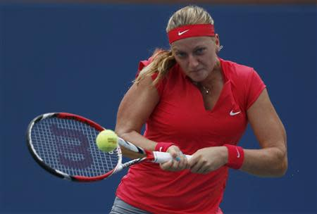 Petra Kvitova of the Czech Republic hits a return to Alison Riske of the U.S. at the U.S. Open tennis championships in New York August 31, 2013. REUTERS/Eduardo Munoz