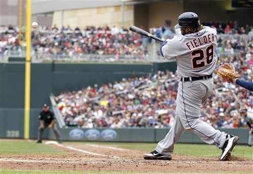 Detroit Tigers' Prince Fielder hits in the fifth inning off Minnesota Twins pitcher Carl Pavano during their baseball game in Minneapolis, Saturday, May 26, 2012. (AP Photo/Andy King)