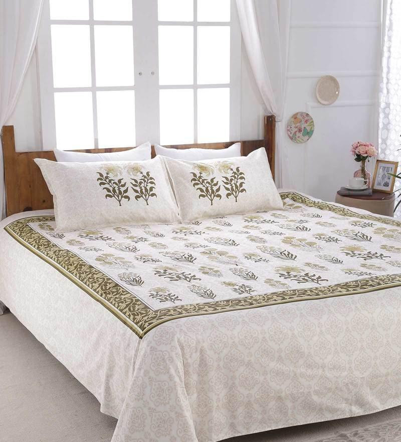 "To keep your bed cover from looking plain and boring, add subtle prints in the form of colours. Mini prints in neutral shades can be extremely pleasing, like this <a href=""https://fave.co/2PE347X"">Floral Pattern 300 TC Cotton King Size Bed Sheet With 2 Pillow Covers By SleepDove</a> (available at a discounted price of Rs. 1,418)."