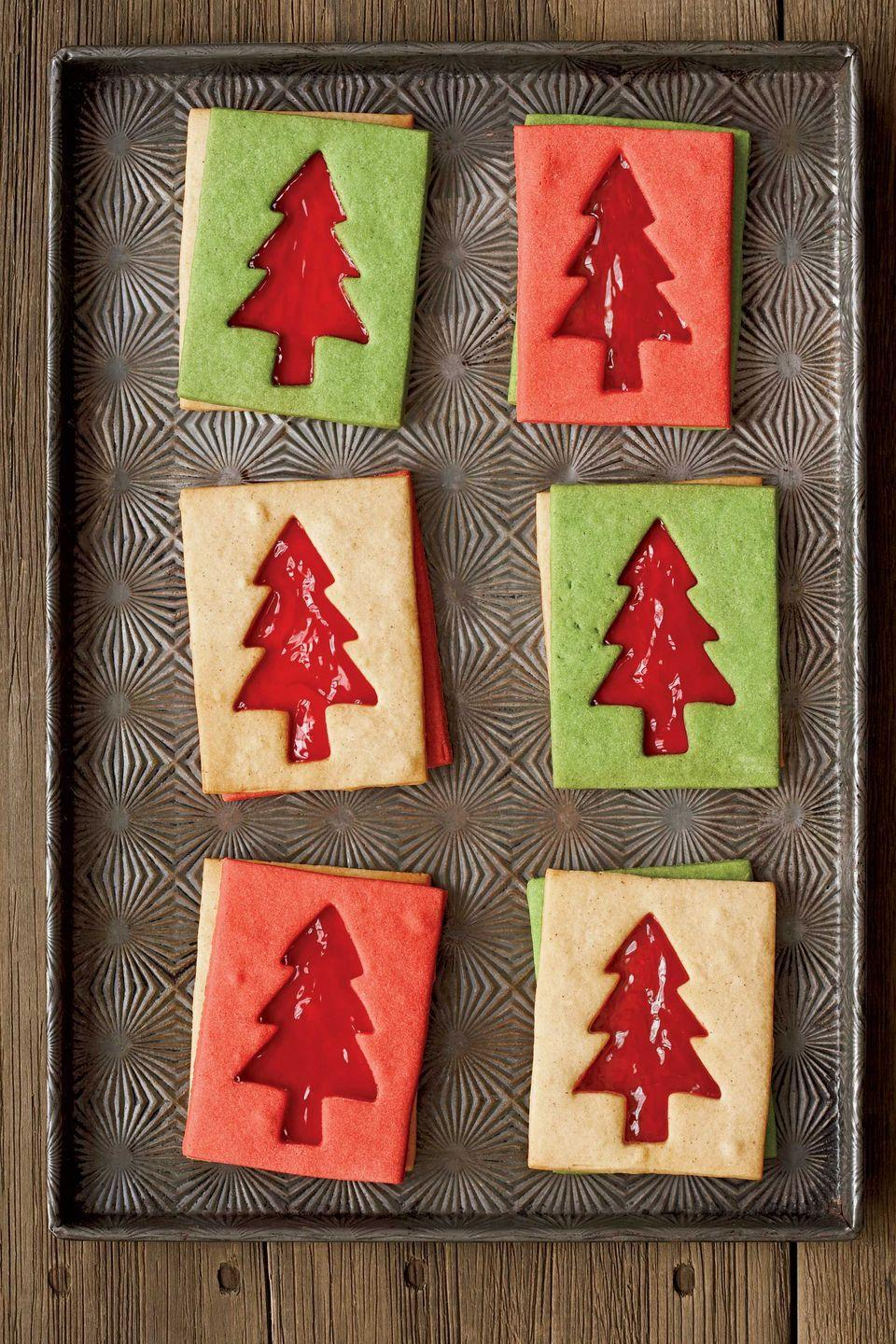"<p>This smart take on traditional Christmas tree cookies uses colored dough and the negative shapes to make delicious Linzer-style cookie sandwiches. Smucker's jelly or preserves are a good choice.</p><p><strong><a href=""https://www.countryliving.com/food-drinks/recipes/a2022/sugar-cookie-dough-clv1207/"" rel=""nofollow noopener"" target=""_blank"" data-ylk=""slk:Get the recipe"" class=""link rapid-noclick-resp"">Get the recipe</a>.</strong></p><p><strong><a class=""link rapid-noclick-resp"" href=""https://www.amazon.com/dp/B01MAWSYOU/?tag=syn-yahoo-20&ascsubtag=%5Bartid%7C10050.g.2777%5Bsrc%7Cyahoo-us"" rel=""nofollow noopener"" target=""_blank"" data-ylk=""slk:SHOP TREE COOKIE CUTTERS"">SHOP TREE COOKIE CUTTERS</a><br></strong></p>"