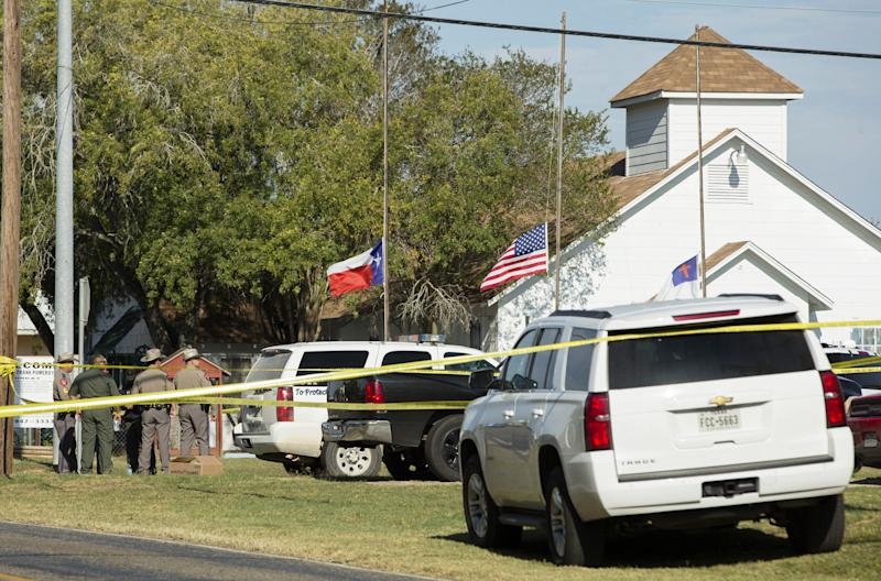 Law enforcement officials gather near the First Baptist Church. (Erich Schlegel/Getty Images)