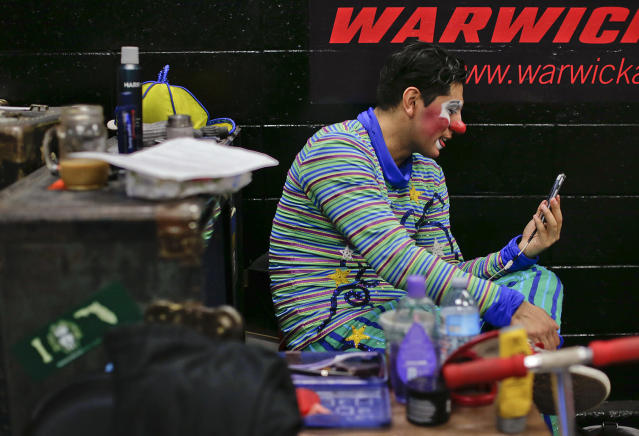 <p>Ringling Bros. clown Ivan Vargas speaks on a video call with his parents during the intermission of a show, Friday, May 5, 2017, in Providence, R.I. Vargas' parents work with Ringling's other circus unit, the blue unit, which will be finishing up in Uniondale, N.Y. on Sunday. (Photo: Julie Jacobson/AP) </p>