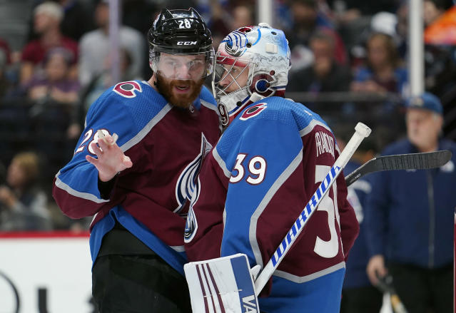 Colorado Avalanche defenseman Ian Cole (28) talks with goal tender Pavel Francouz (39) during the third period of an NHL hockey game against the Columbus Blue Jackets, Saturday, Nov. 9, 2019, in Denver. (AP Photo/Jack Dempsey)