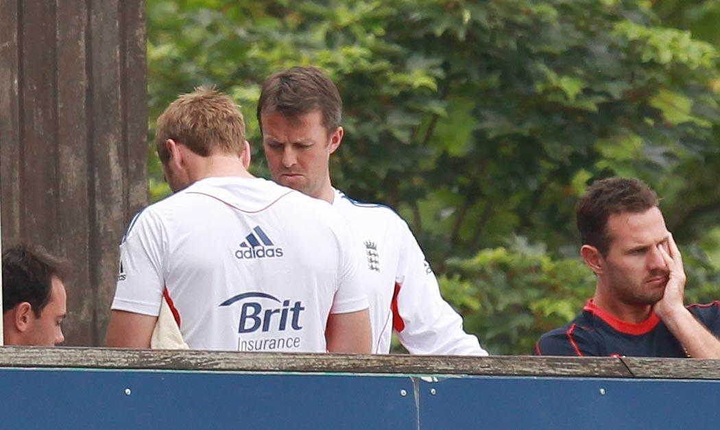 Graeme Swann gets treatment in the pavillion after being hit on the arm by Tymal Mills during day two of the International Warm up match at The County Ground, Chelmsford.
