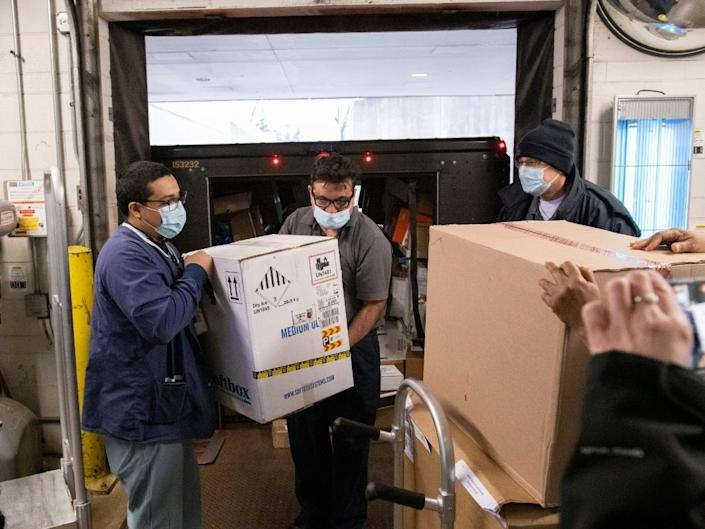 The first doses of the Pfizer-BioNTech vaccine are unloaded from a UPS truck on Dec. 17 at Glenbrook Hospital. (Jon Hillenbrand/NorthShore)