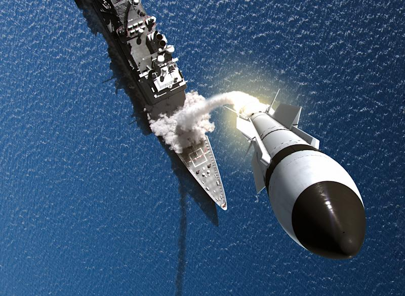 A Raytheon SM-3 interceptor in action over a ship at sea.