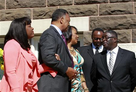 (L-R) U.S. Representative Terri Sewell, civil rights activist Reverend Jesse Jackson and Baptist minister Bernice King exit the church to go to the bell ringing and laying of the wreath at 10:22 at 16th Street Baptist Church in Birmingham, Alabama September 15, 2013. REUTERS/Marvin Gentry