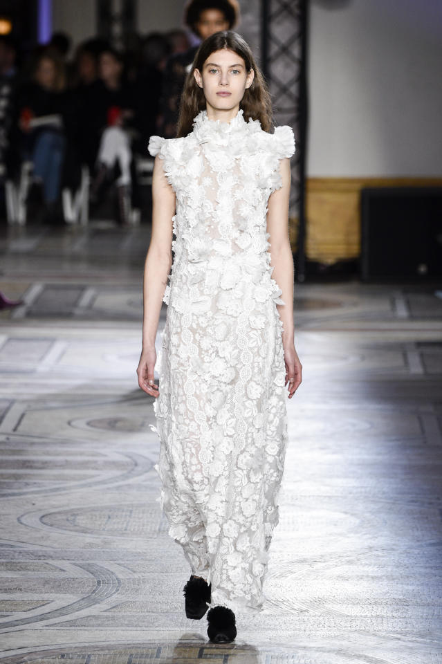 <p>This lace look from Giambattista Valli would be a spring-appropriate, fashion-forward choice for Markle. (Photo: Getty Images) </p>