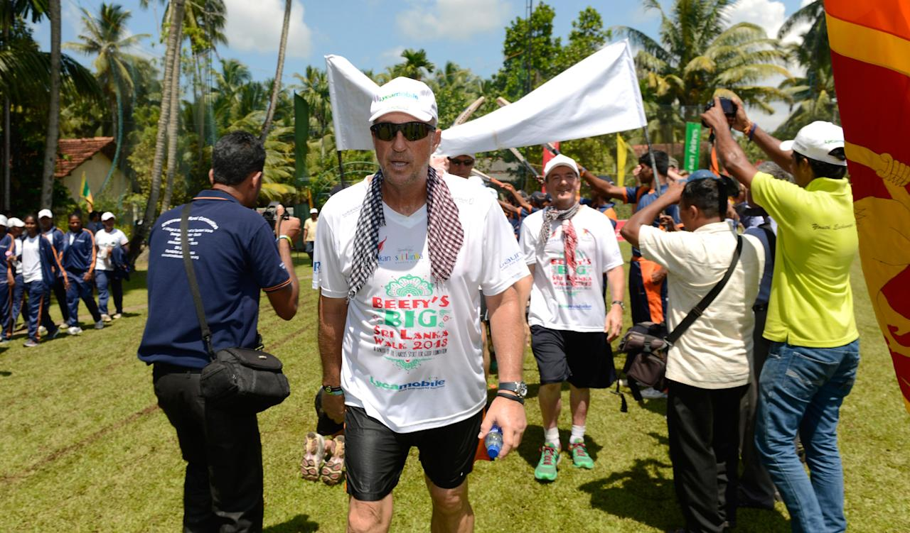 SEENIGAMA, SRI LANKA - NOVEMBER 08:  In this handout image provided by Laureus, Sir Ian Botham finishing with his team on the eighth and final day of Beefy's Big Sri Lanka walk 2013 walk on November 8, 2013 from Galle to Seenigama, Sri Lanka.  (Photo by Philip Brown/Laureus via Getty Images)