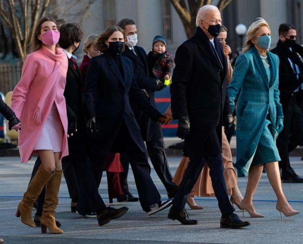 PHOTO: President Joe Biden, first lady Jill Biden and their family walk the abbreviated parade route after Biden's inauguration on Jan. 20, 2021, in Washington, D.C. (Mark Makela/Getty Images)