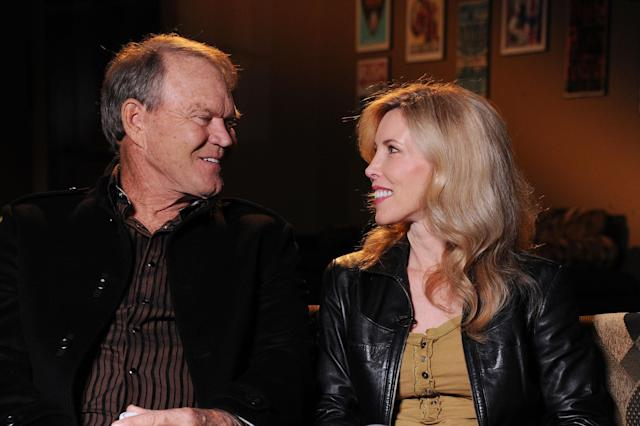 <span>Glen Campbell and Kimberly Campbell at the Bridgestone Arena in Nashville, Tenn., on Sept. 19, 2011. (Photo:Rick Diamond/Getty Images North America)</span>