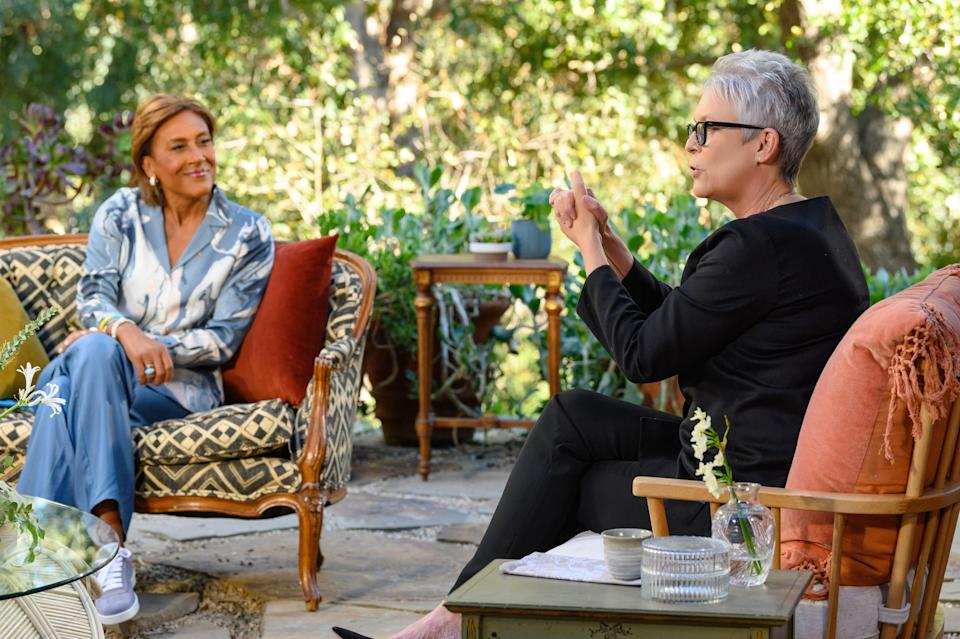 """Robin Roberts listens intently to her """"Turning the Tables"""" guest, """"Halloween"""" actress Jamie Lee Curtis."""