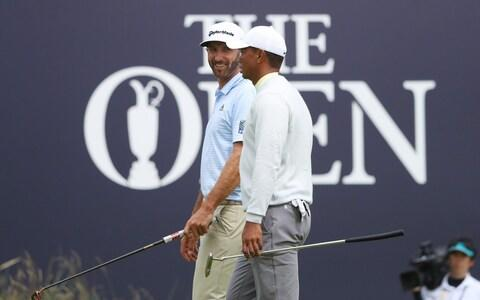 Dustin Johnson of the United States talks to Tiger Woods of the United States during a practice round prior to the 148th Open Championship held on the Dunluce Links at Royal Portrush Golf Club - Credit: GETTY IMAGES