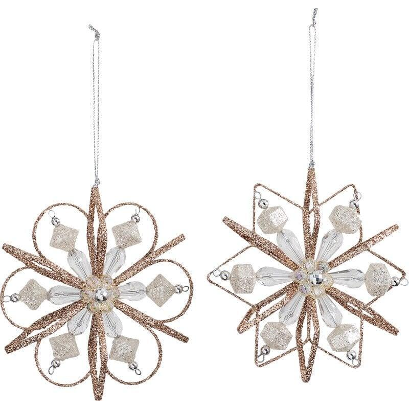 <p>This beautifully detailed 2 piece <span>Snowflake Holiday Shaped Ornament Set</span> ($34, originally $48) will add some vintage charm to any tree. </p>