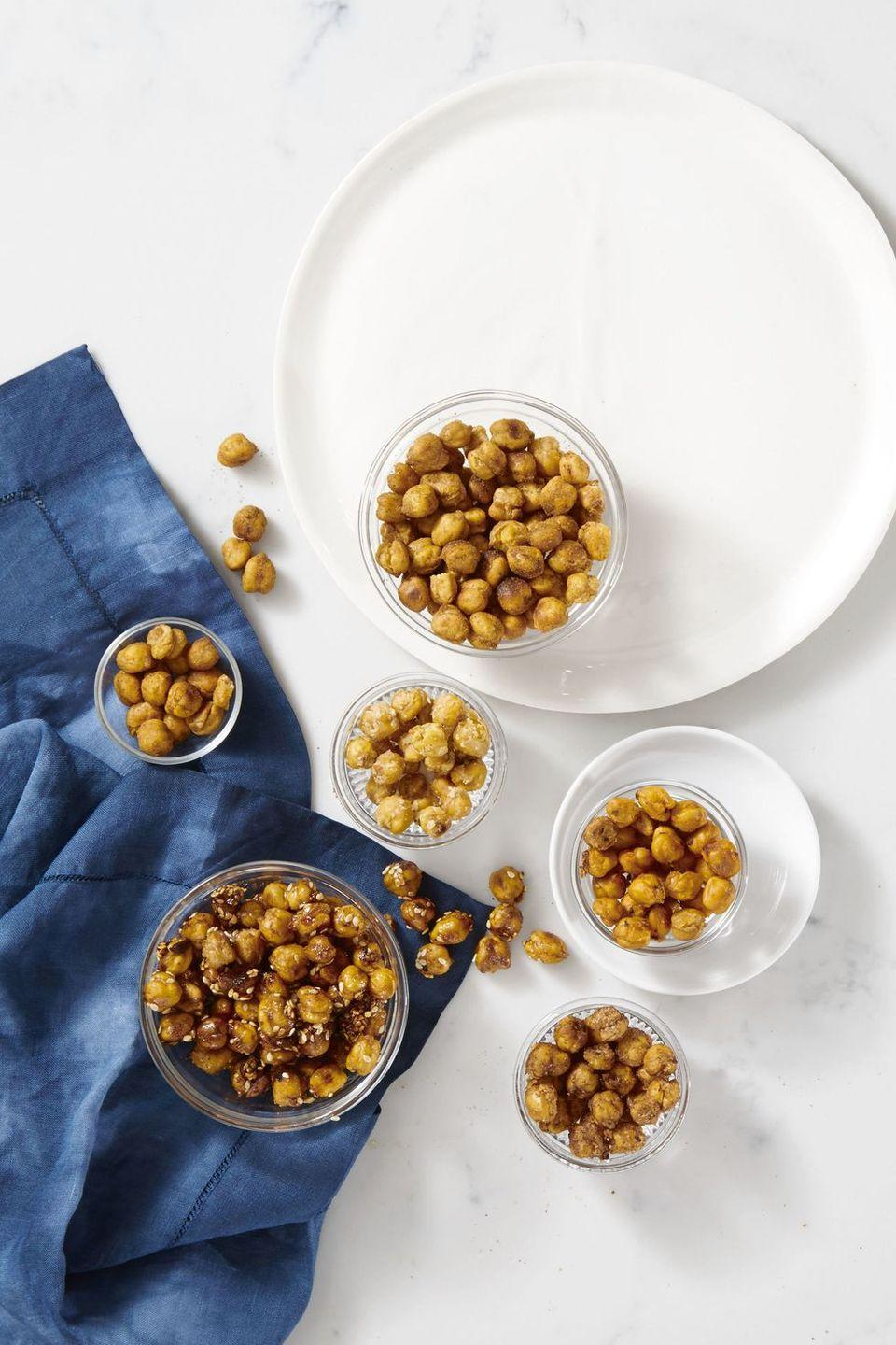 """<p>Make crispy chickpeas in the air fryer instead of the oven for a protein-packed snack.</p><p><em><a href=""""https://www.goodhousekeeping.com/food-recipes/a40814/chickpea-nuts-recipe/"""" rel=""""nofollow noopener"""" target=""""_blank"""" data-ylk=""""slk:Get the recipe for Chickpea &quot;Nuts&quot; »"""" class=""""link rapid-noclick-resp"""">Get the recipe for Chickpea """"Nuts"""" »</a></em></p>"""