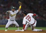 Oakland Athletics second baseman Tony Kemp holds up the ball after tagging out Los Angeles Angels' Shohei Ohtani on an attempted steal during the sixth inning of a baseball game Friday, July 30, 2021, in Anaheim, Calif. (AP Photo/John McCoy)