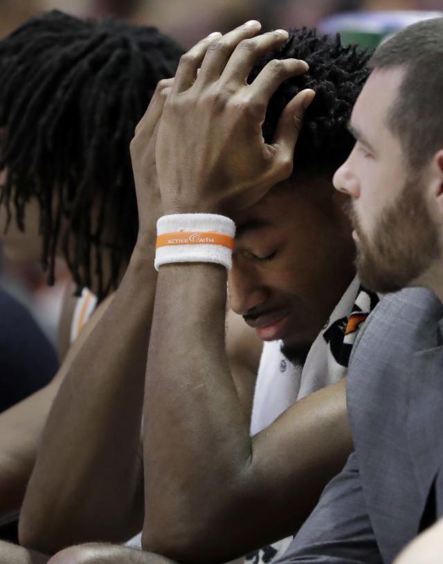 Tennessee's Kyle Alexander sits on the bench in the second half of the NCAA college basketball Southeastern Conference championship game against Auburn Sunday, March 17, 2019, in Nashville, Tenn. (AP Photo/Mark Humphrey)