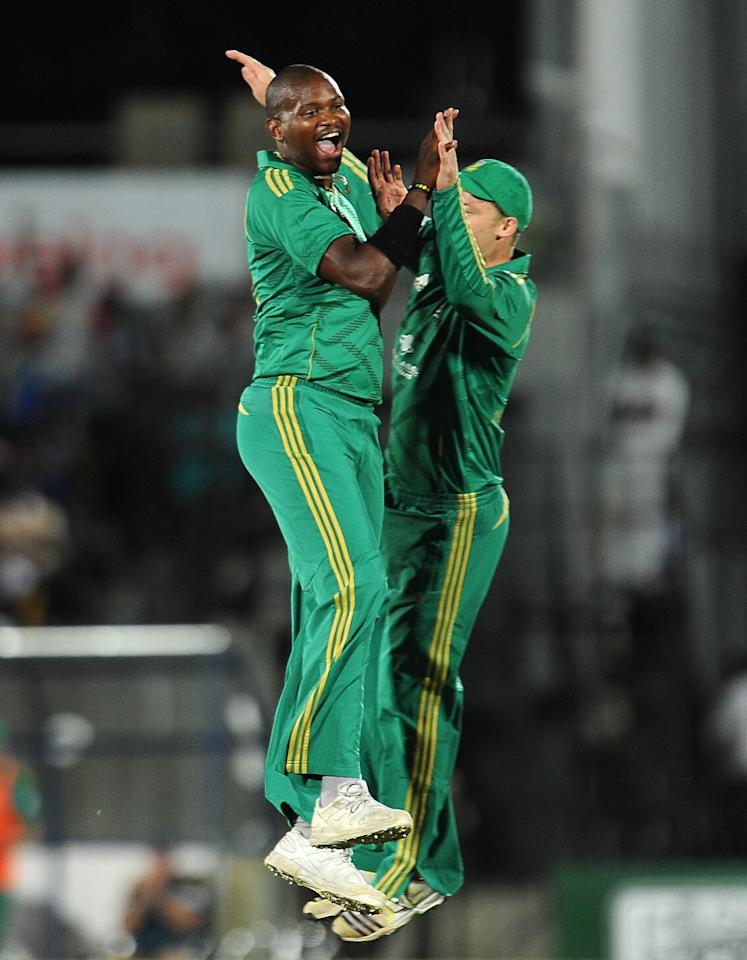 South African cricketer Lonwabo Tsotsobe (L) celebrates with teammate David Miller after he dismissed Sri Lankan captain Dinesh Chandimal during the second Twenty20 cricket match between Sri Lanka and South Africa at the Suriyawewa Mahinda Rajapakse International Cricket Stadium in the southern district of Hambantota on August 4,2013. AFP PHOTO / LAKRUWAN WANNIARACHCHI