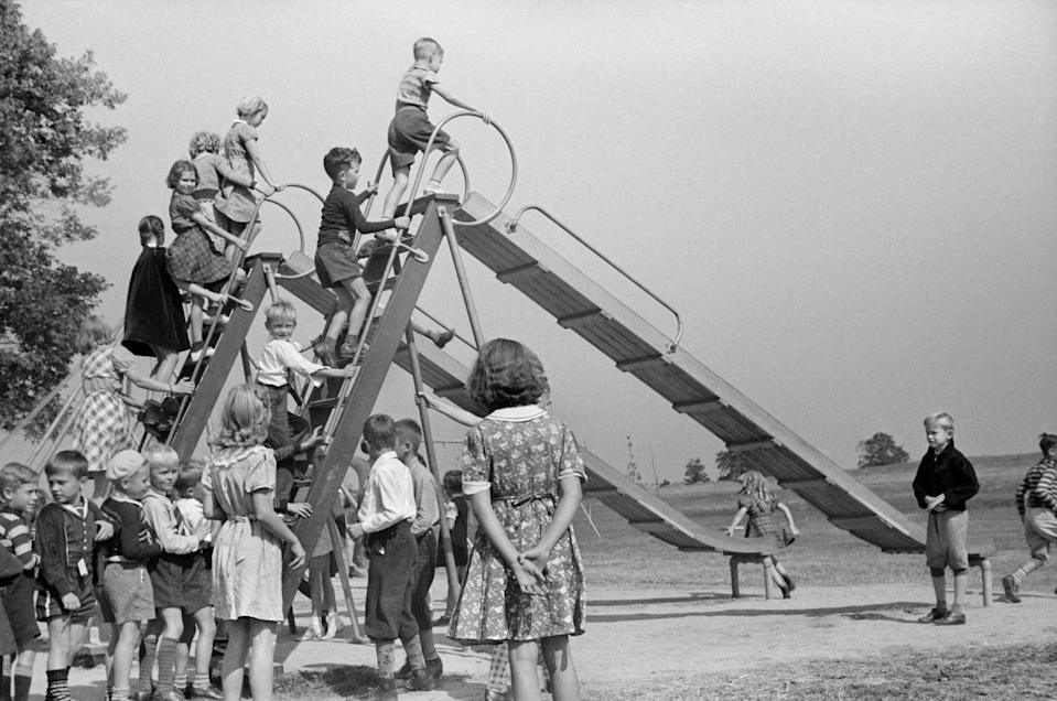 """<p>Children taking turns on the slide at a school playground in Greenhills, Ohio.</p><p><strong>RELATED: </strong><a href=""""https://www.goodhousekeeping.com/life/g22550711/back-to-school-activities/"""" rel=""""nofollow noopener"""" target=""""_blank"""" data-ylk=""""slk:20 Back-to-School Activities That Will Make Kids Excited About Learning"""" class=""""link rapid-noclick-resp"""">20 Back-to-School Activities That Will Make Kids Excited About Learning</a></p>"""