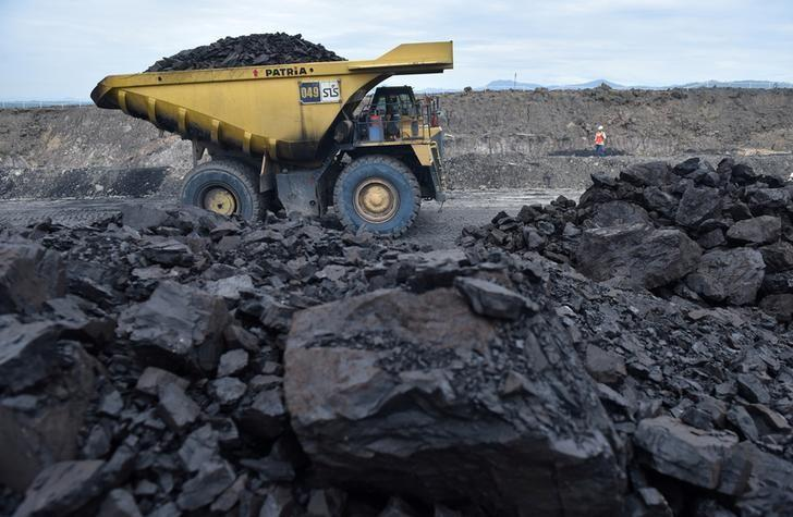 FILE PHOTO: A truck carries coal at PT Adaro Indonesia coal mining in Tabalong