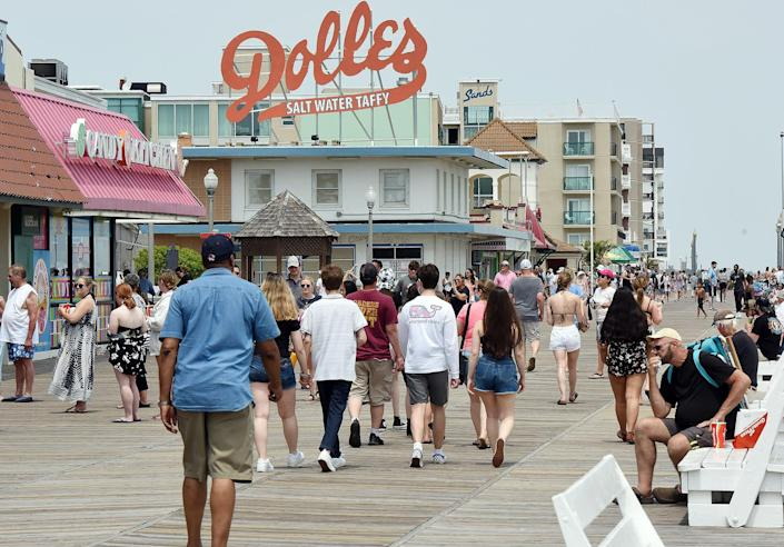Weekend visitors fill Rehoboth Beach on May 22, a day after some of Delaware's mask rules were loosened.