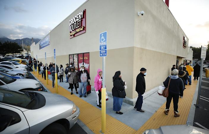 "Shoppers lined up before dawn outside the Grocery Outlet Bargain Market in Altadena on Thursday as the store opened before 7 a.m. for seniors. <span class=""copyright"">(Al Seib/Los Angeles Times)</span>"