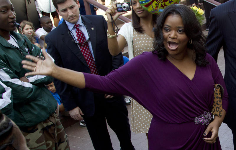 Oscar-winning actress Octavia Spencer arrives at the Alabama Statehouse in Montgomery, Ala., Wednesday, March 21, 2012. Spencer was greeted by more than 400 people as she arrived at the Statehouse to a hero's welcome. Earlier this year, Spencer won a best supporting actress Oscar for her performance in The Help. (AP Photo/Dave Martin)