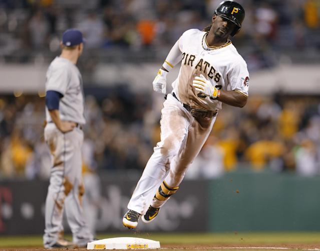 Pittsburgh Pirates' Andrew McCutchen, right, rounds third base past San Diego Padres third baseman Chase Headley after hitting a home run in the seventh inning of a baseball game Wednesday, Sept. 18, 2013, in Pittsburgh. (AP Photo/Keith Srakocic)