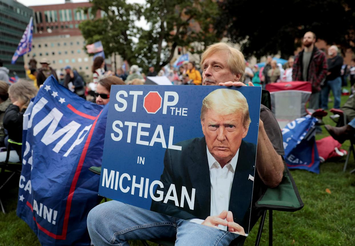 Supporters of former U.S. President Donald Trump gather outside the Michigan State Capitol to demand an audit of 2020 election votes, in Lansing, Michigan, U.S. October 12, 2021. (Rebecca Cook/Reuters)