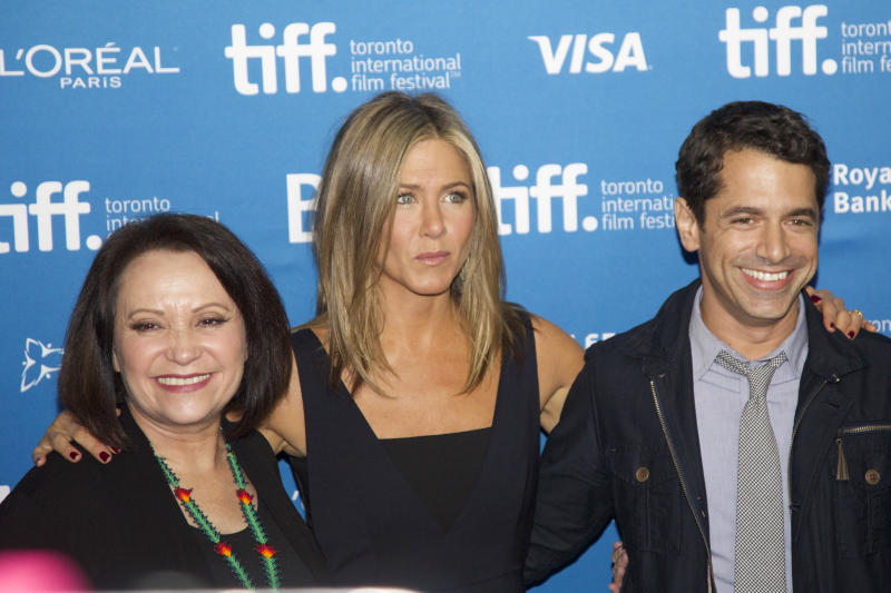 Actress Adriana Barraza, actress Jennifer Aniston, director Daniel Barnz pose at 'Cake' Press Conference during the 2014 Toronto International Film Festival (Photo by Michael Hurcomb/Corbis via Getty Images)
