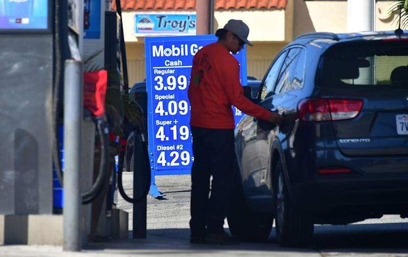 A driver closes the cap after filling up at a Los Angeles gas station on April 9, 2019, as southern California gas prices, already the highest in the nation, continue to rise. (Photo by Frederic J. BROWN / AFP) (Photo credit should read FREDERIC J. BROWN/AFP/Getty Images)