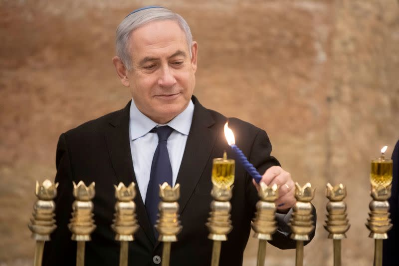 FILE PHOTO: Israel's PM Netanyahu lights first candle of Hanukkah