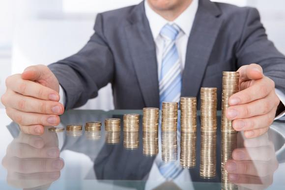 Man with stacks of coins