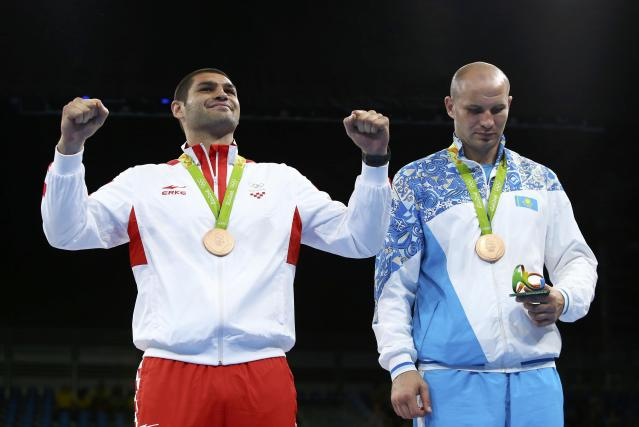 2016 Rio Olympics - Boxing - Victory Ceremony - Men's Super Heavy (+91kg) Victory Ceremony - Riocentro - Pavilion 6 - Rio de Janeiro, Brazil - 21/08/2016. Bronze medallist Filip Hrgovic (CRO) of Croatia reacts next to fellow bronze medallist Ivan Dychko (KAZ) of Kazakhstan. REUTERS/Peter Cziborra FOR EDITORIAL USE ONLY. NOT FOR SALE FOR MARKETING OR ADVERTISING CAMPAIGNS.