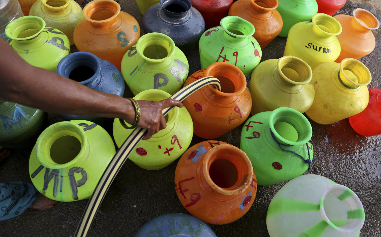 <p>An Indian woman fills plastic vessels with water from a shared tap in an impoverished neighborhood, on World Water Day in Bangalore, India, Thursday, March 22, 2018. Bangalore is one among ten cities in the world that might be on the verge of an imminent water crisis like the one in South Africa's drought-hit city of Cape Town, the environmental magazine Down to Earth claimed earlier this week. (AP Photo/Aijaz Rahi) </p>