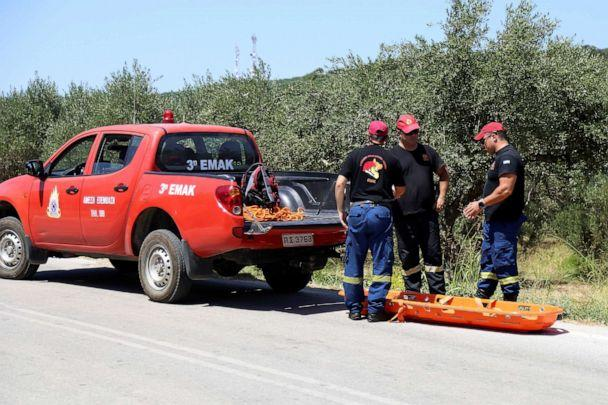 PHOTO: Members of a search and rescue team of the fire brigade prepare to retrieve the body of a woman found near the village of Kolimpari on the island of Crete, Greece, July 9, 2019. (Makis Kartsonakis/Reuters)