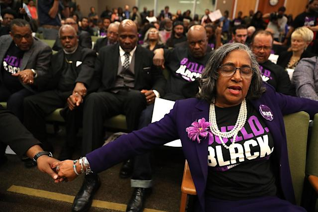 <p>Attendees pray after Stevante Clark, brother of Stephon Clark, disrupted a special city council meeting at Sacramento City Hall on March 27, 2018 in Sacramento, Calif. (Photo: Justin Sullivan/Getty Images) </p>