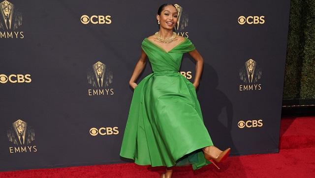 Yara Shahidi wore a Cartier necklace of yellow gold, emeralds and diamonds as she twirled in a princess gown of kelly green by Dior (AP Photo)