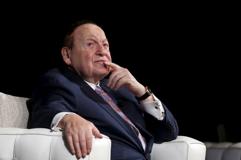 FILE PHOTO: Gambling giant Las Vegas Sands Corp's Chief Executive Sheldon Adelson reacts during a news conference in Macau, China