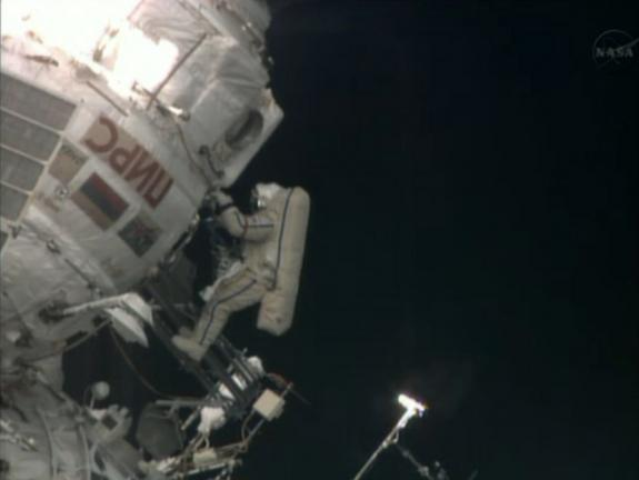 Russian cosmonaut Pavel Vinogradov floats outside the International Space Station near the end of a 6.5-hour spacewalk on April 19, 2013. Vinogradov, 59, became the world's oldest spacewalker during the excursion.