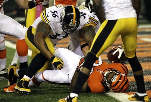 Cincinnati Bengals running back Cedric Peerman (30) falls into the end zone for a five-yard touchdown past Pittsburgh Steelers linebacker LaMarr Woodley (56) during the first half of an NFL football game, Sunday, Oct. 21, 2012, in Cincinnati. (AP Photo/Tom Uhlman)