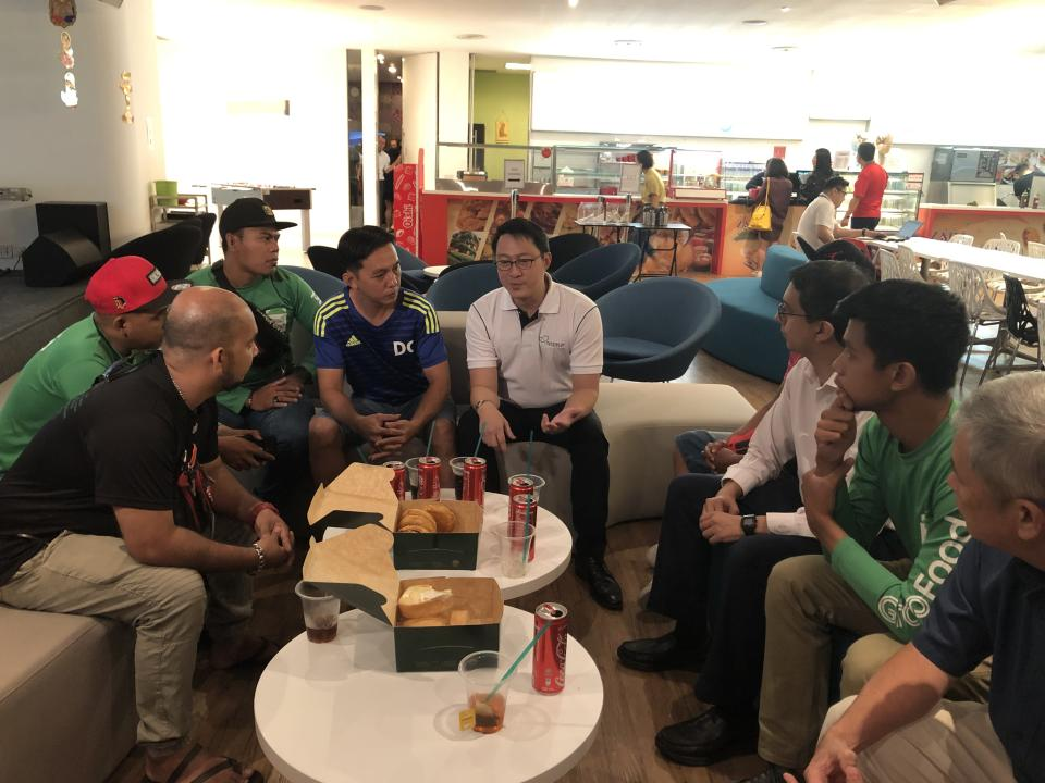 Senior Minister of State Lam Pin Min speaks to food delivery riders at the Land Transport Authority headquarters on 8 November, 2019. (PHOTO: Nicholas Yong/Yahoo News Singapore)