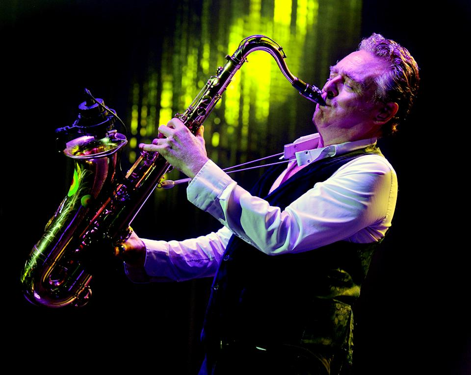 MANCHESTER, ENGLAND - DECEMBER 17:  Brian Travers of UB40 performs live on stage at O2 Apollo Manchester on December 17, 2017 in Manchester, England.  (Photo by Shirlaine Forrest/WireImage)