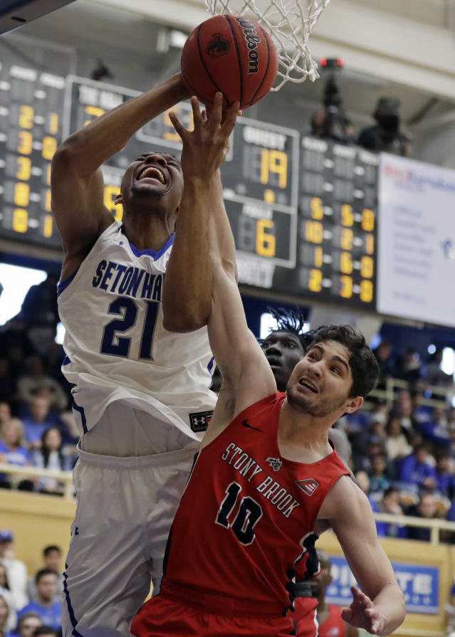 Seton Hall center Ike Obiagu (21) is fouled by Stony Brook guard Jordan Mckenzie (10) during the first half of an NCAA college basketball game Saturday, Nov. 9, 2019, in South Orange, N.J. (AP Photo/Adam Hunger)
