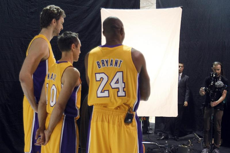 Los Angeles Lakers forward Pau Gasol, left, of Spain, guard Steve Nash, center, and guard Kobe Bryant, right, pose for photographs during the NBA basketball team's media day Saturday, Sept. 28, 2013, in El Segundo, Calif. (AP Photo/Alex Gallardo)