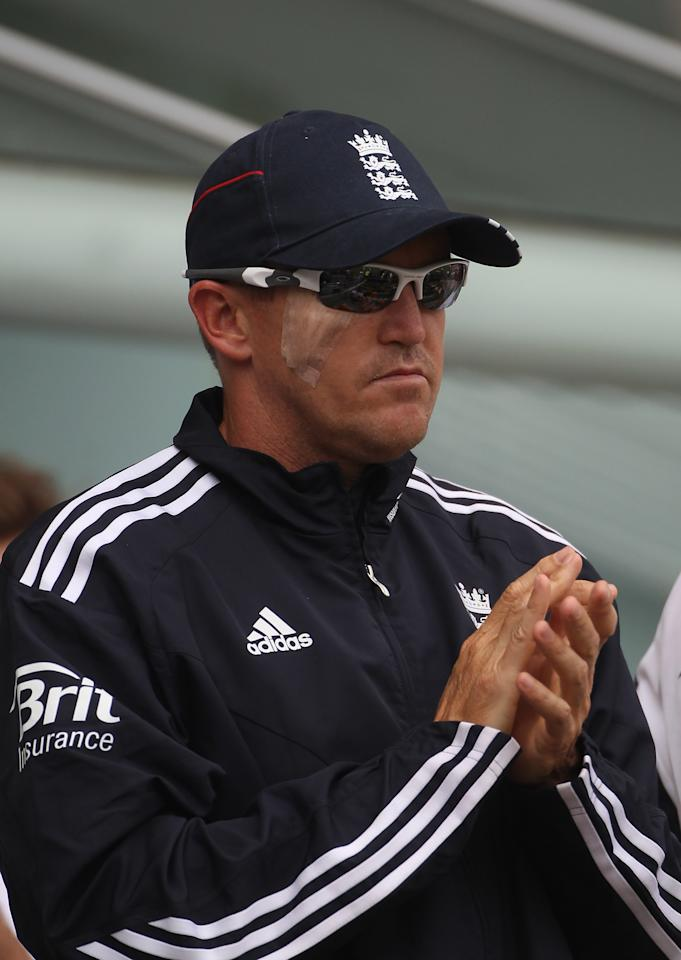 BRISBANE, AUSTRALIA - NOVEMBER 28: England coach Andy Flower looks on after having an operation to remove a skin cancer near his right eye during day four of the First Ashes Test match between Australia and England at The Gabba on November 28, 2010 in Brisbane, Australia.  (Photo by Tom Shaw/Getty Images)