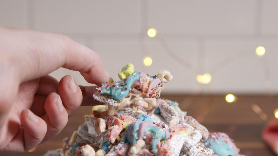 """<p>Peanut butter, chocolate, Lucky Charms — what more could you want?!</p><p>Get the recipe from <a href=""""/cooking/recipe-ideas/recipes/a51019/rainbow-muddy-buddies-recipe/"""" data-ylk=""""slk:Delish"""" class=""""link rapid-noclick-resp"""">Delish</a>.</p>"""