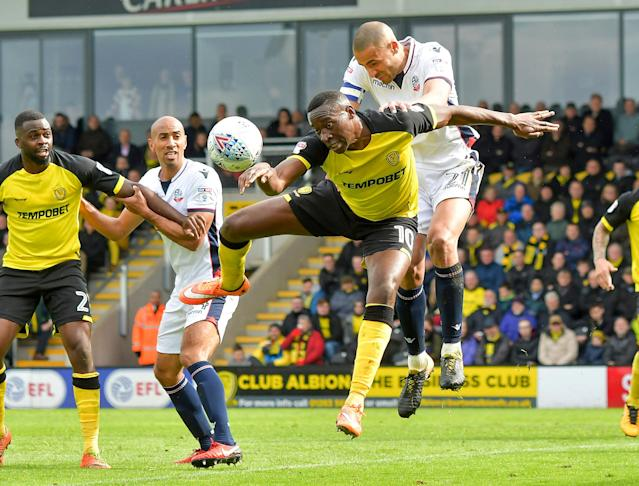 "Soccer Football - Championship - Burton Albion vs Bolton Wanderers - Pirelli Stadium, Burton, Britain - April 28, 2018 Burton Albion's Lucas Akins in action with Bolton Wanderers' Darren Pratley Action Images/Paul Burrows EDITORIAL USE ONLY. No use with unauthorized audio, video, data, fixture lists, club/league logos or ""live"" services. Online in-match use limited to 75 images, no video emulation. No use in betting, games or single club/league/player publications. Please contact your account representative for further details."