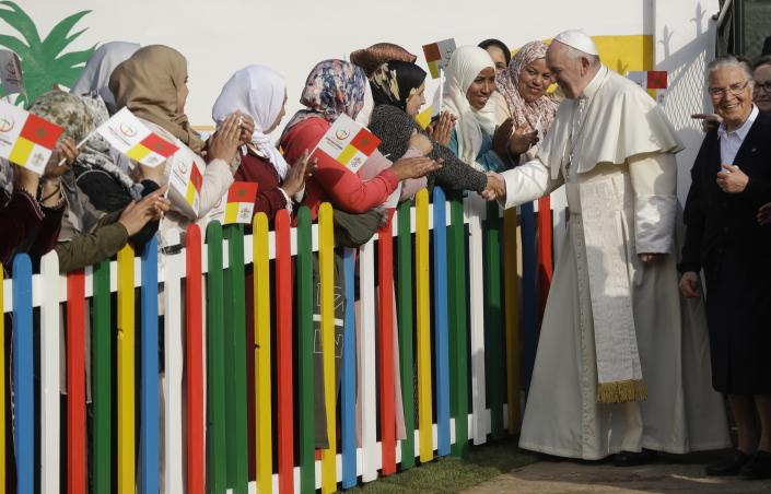 Pope Francis greets some women as he arrives to the Rural Center for Social Services at Temara, south of Rabat, Morocco, Sunday, March 31, 2019. Pope Francis is in Morocco for a two-day trip aimed at highlighting the North African nation's Christian-Muslim ties, while also showing solidarity with migrants at Europe's door and tending to a tiny Catholic flock. (AP Photo/Gregorio Borgia)